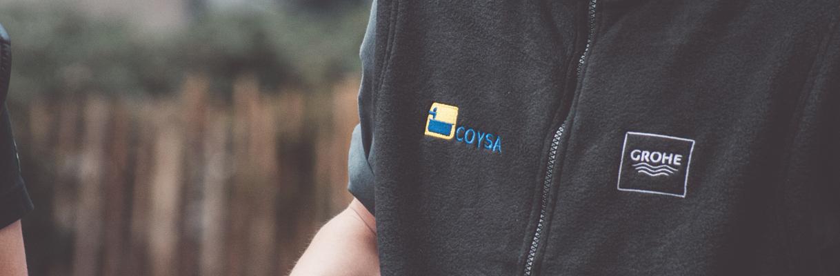 Uniformes Bordados Personalizados para Grohe - Header Image